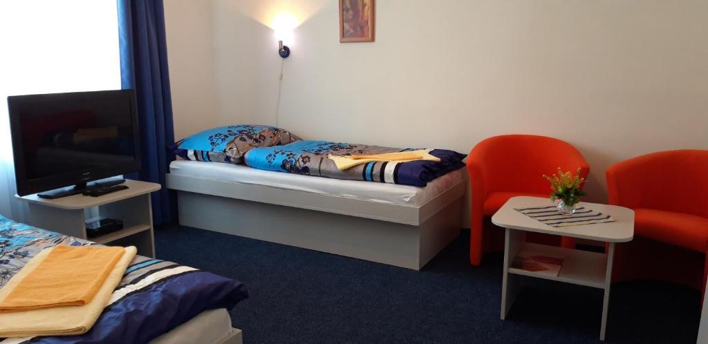 Posteľ alebo postele v izbe v ubytovaní ŠD Němcovej 1