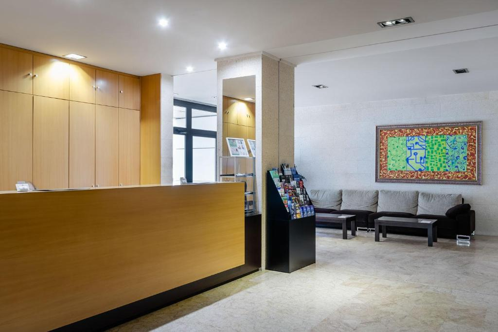The lobby or reception area at Aparthotel Wellness