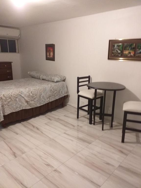 A bed or beds in a room at Malia's Super Studio
