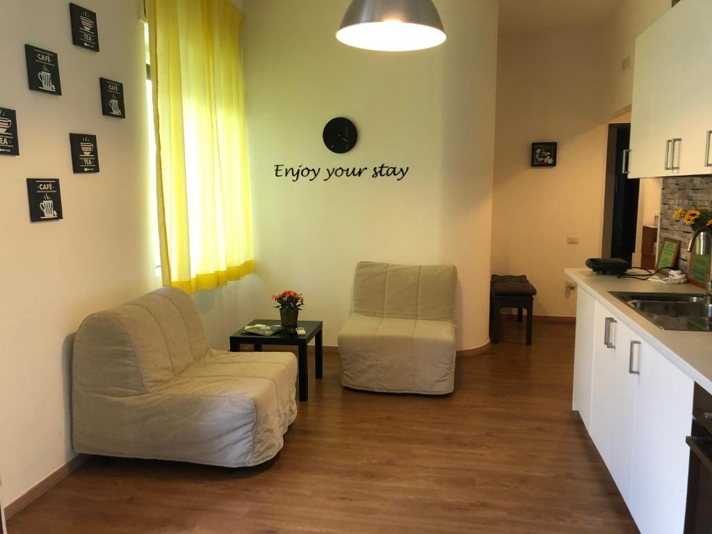 Area soggiorno di Panoramic Rooms Salerno Affittacamere