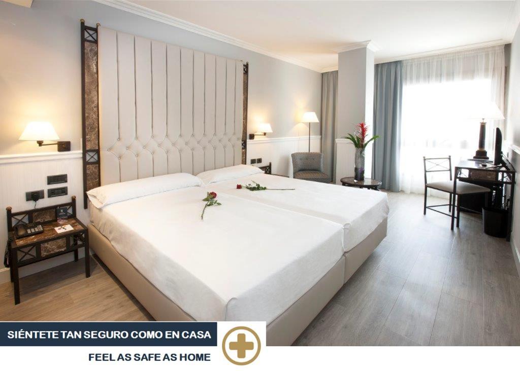 Voodi või voodid majutusasutuse Hotel Gran Via toas