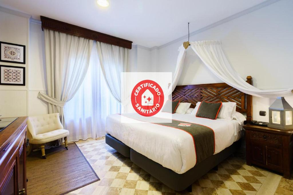 Letto o letti in una camera di OYO Hotel Boutique Reina Mora