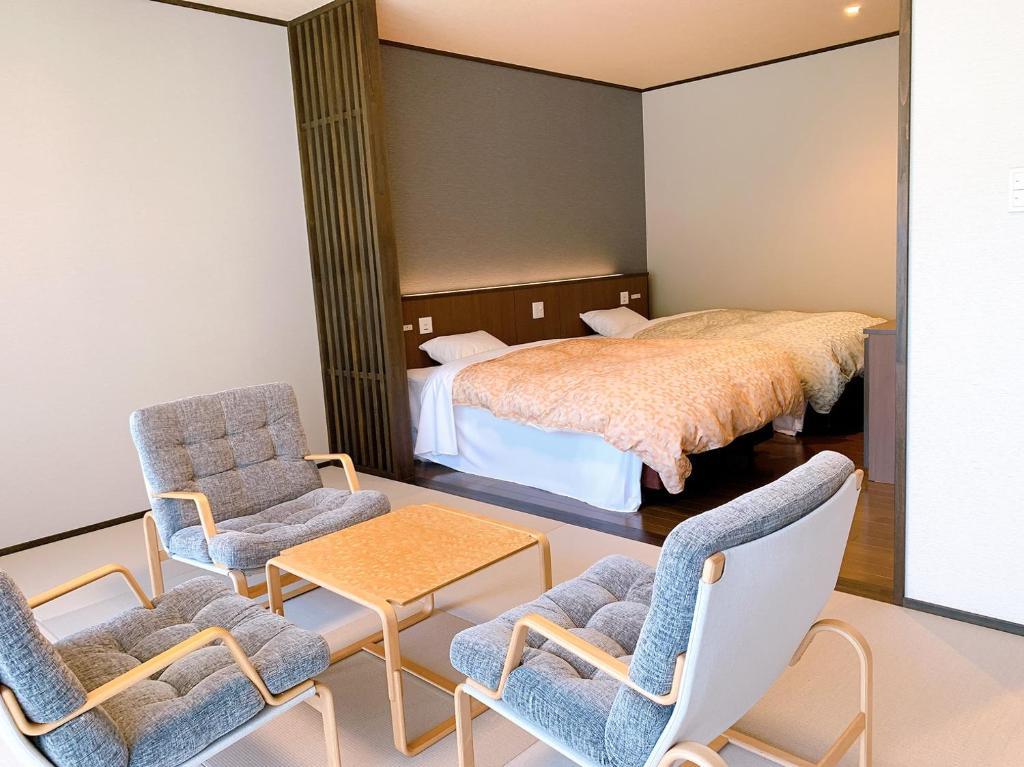 出雲湯村温泉国民宿舎清嵐荘 にあるベッド