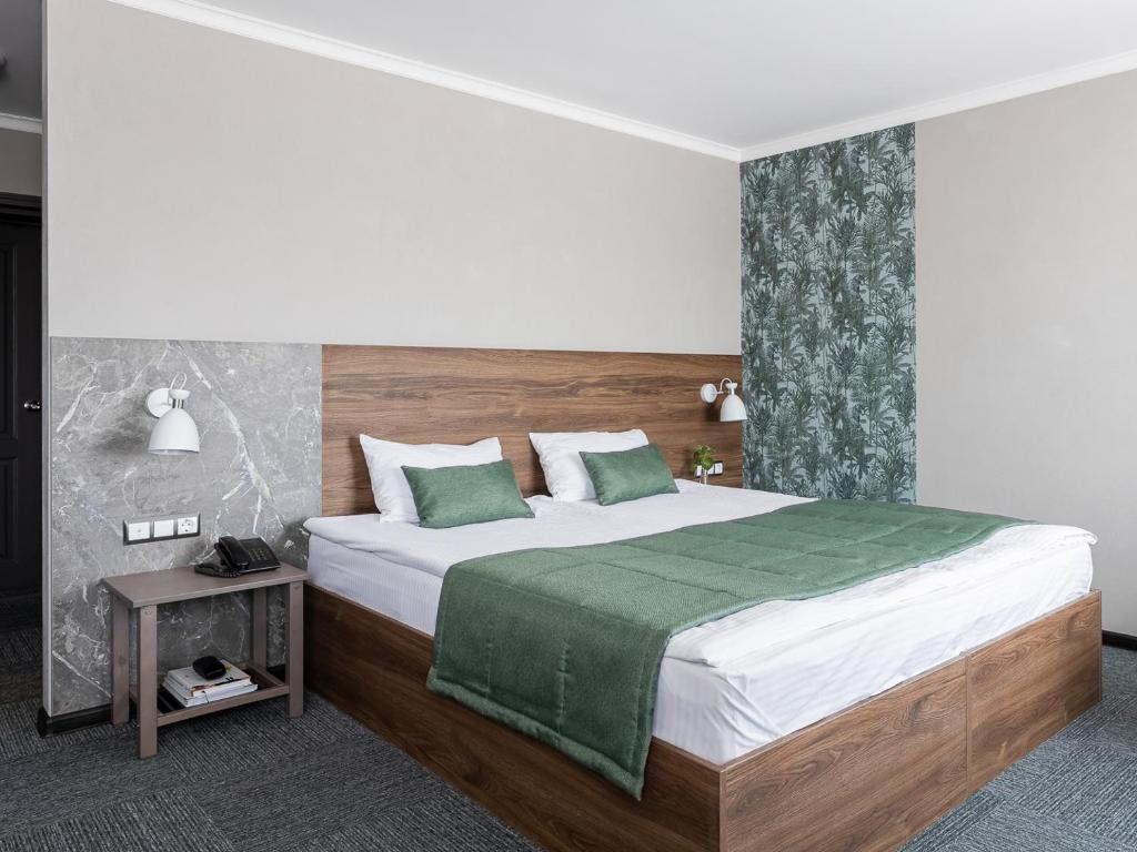 A bed or beds in a room at Chelyabinsk Hotel 4 floor