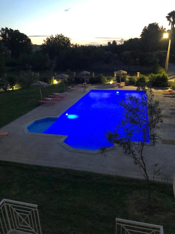 A view of the pool at Mythos apts hotel or nearby