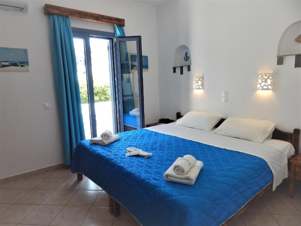 A bed or beds in a room at Aquarius Village Agistri