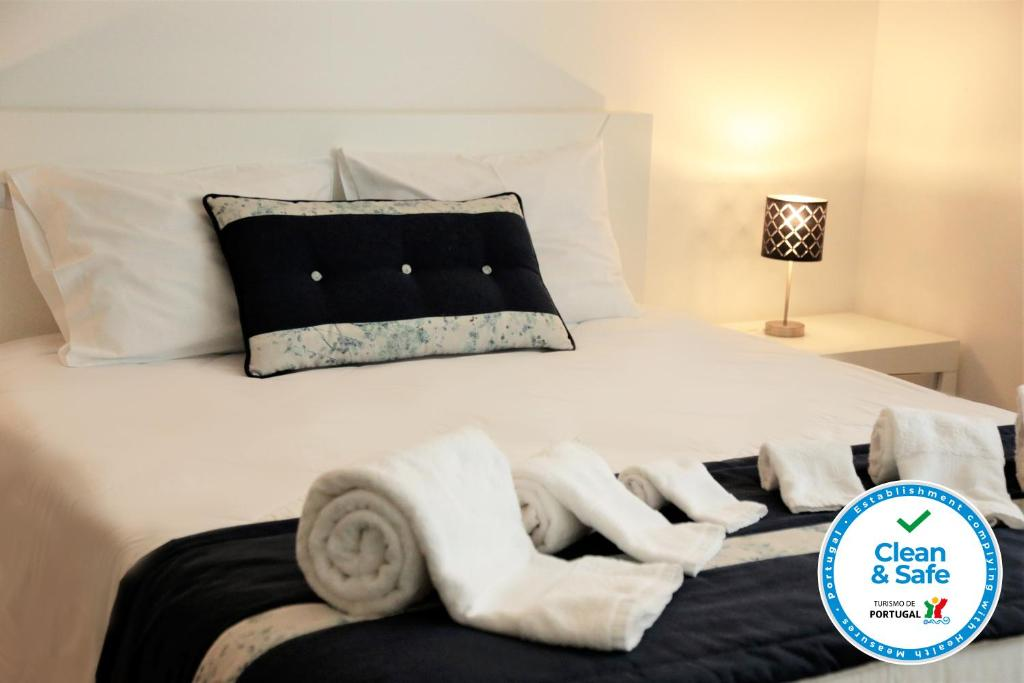 A bed or beds in a room at Coudelaria Residence