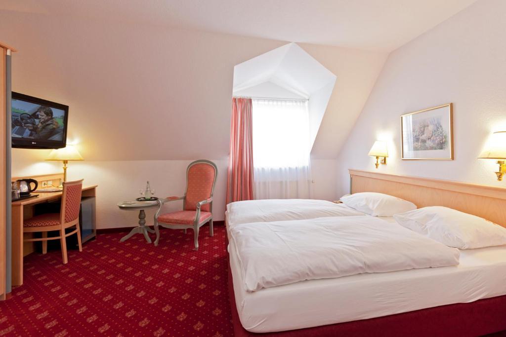Ein Bett oder Betten in einem Zimmer der Unterkunft Hotel Für Dich