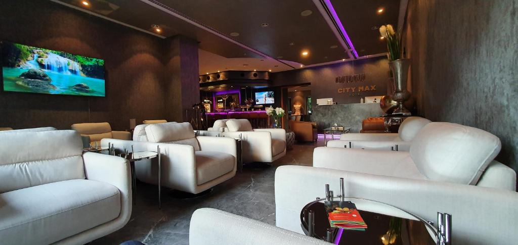 The lounge or bar area at City Max Hotel