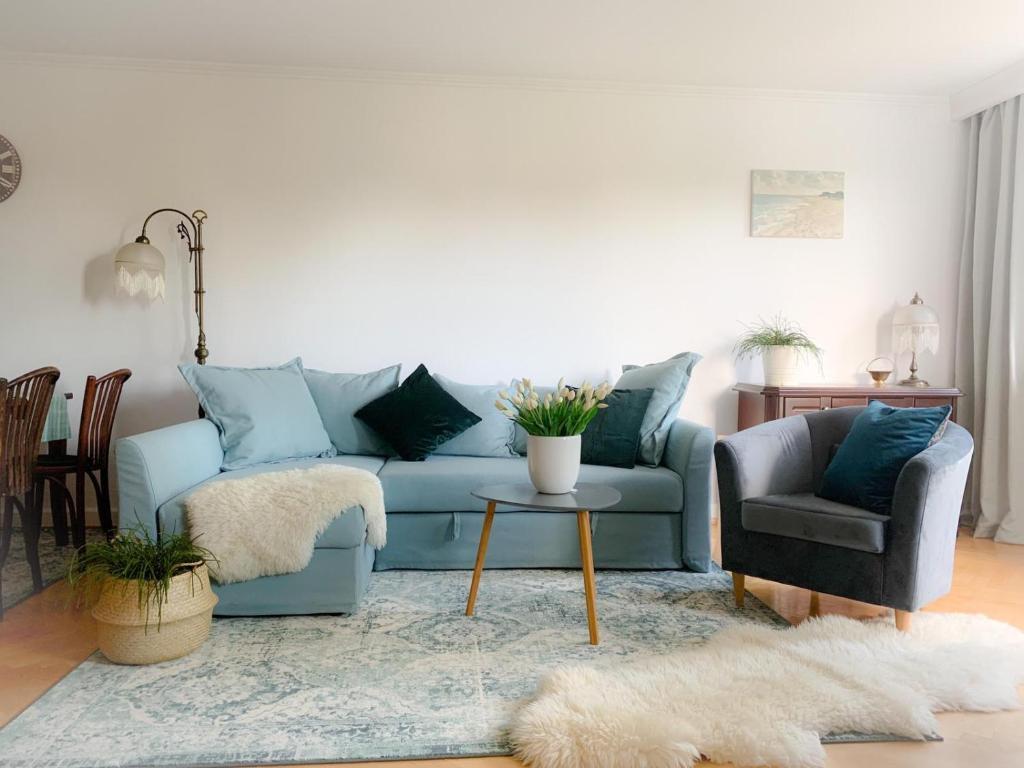 A seating area at Apartament Grunwaldzka
