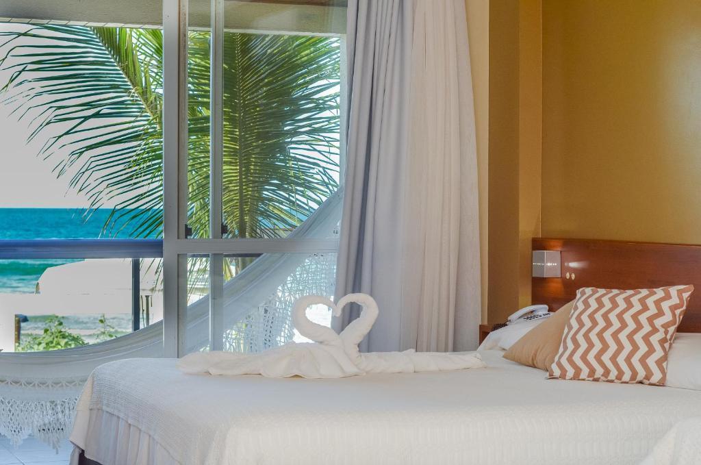 Cama ou camas em um quarto em Pousada Garatéia