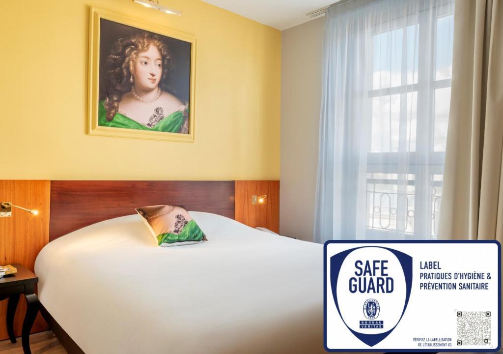 Cama o camas de una habitación en Hotel des Lys