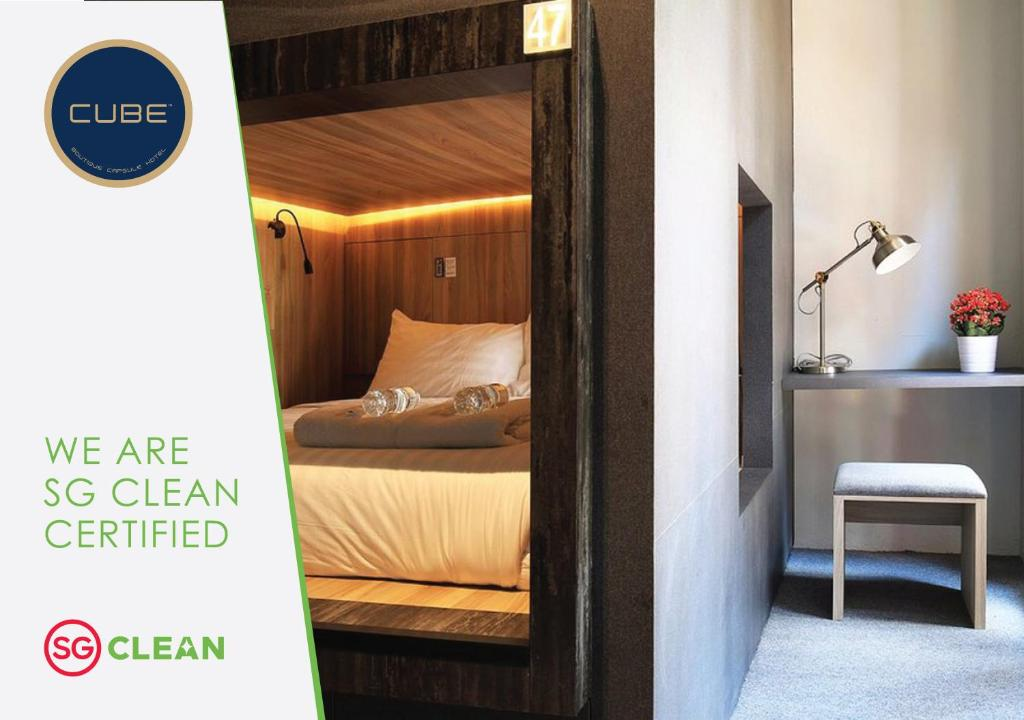 A bed or beds in a room at CUBE Boutique Capsule Hotel @ Chinatown (SG Clean)