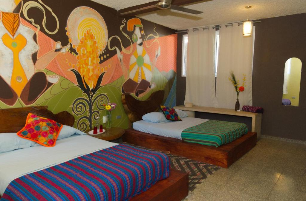 A bed or beds in a room at La Zona Hostel