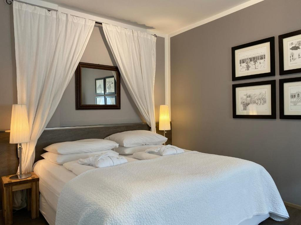 A bed or beds in a room at Bergland Hotel - Adults only