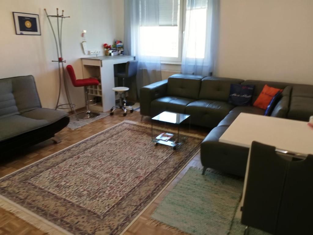 Ein Sitzbereich in der Unterkunft City Apartment