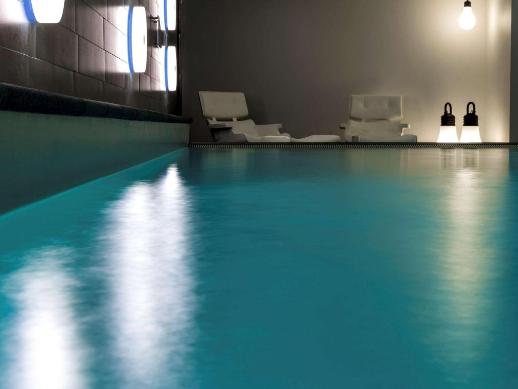The swimming pool at or close to Pullman Eindhoven Cocagne