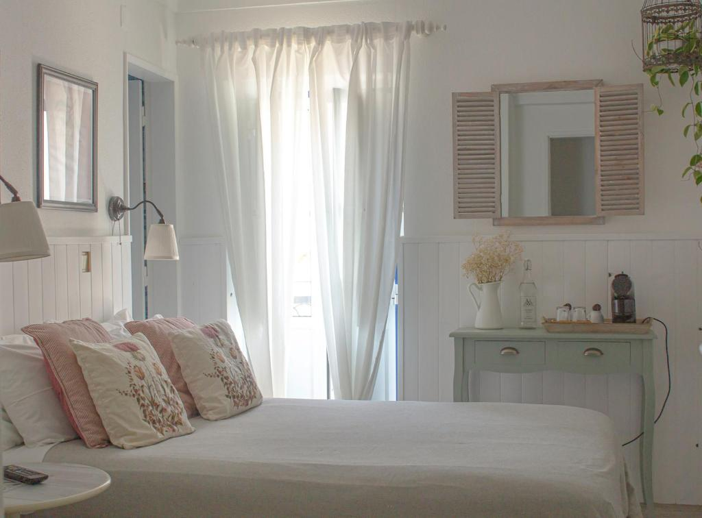 A bed or beds in a room at Vinnus Guesthouse