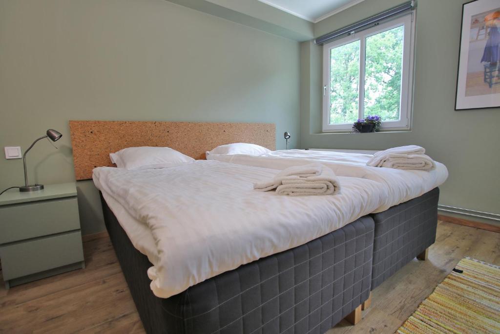 Säng eller sängar i ett rum på Hotell Munkeröd