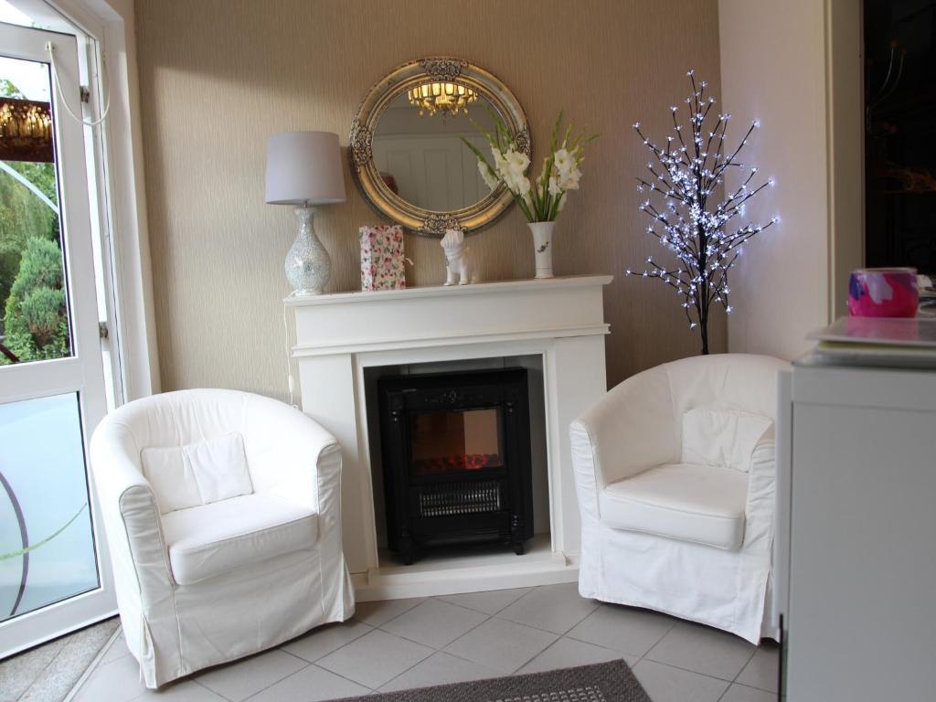 Ein Sitzbereich in der Unterkunft Apartments und Zimmer Gästehaus Matthias