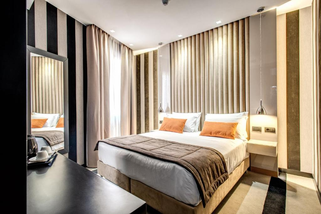 A bed or beds in a room at Doria Palace Boutique Hotel