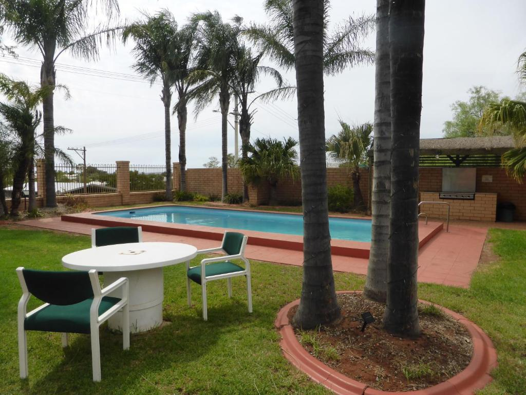 The swimming pool at or near Hilltop Motel