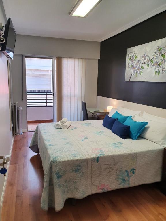 Cama o camas de una habitación en Pensión El Espolón