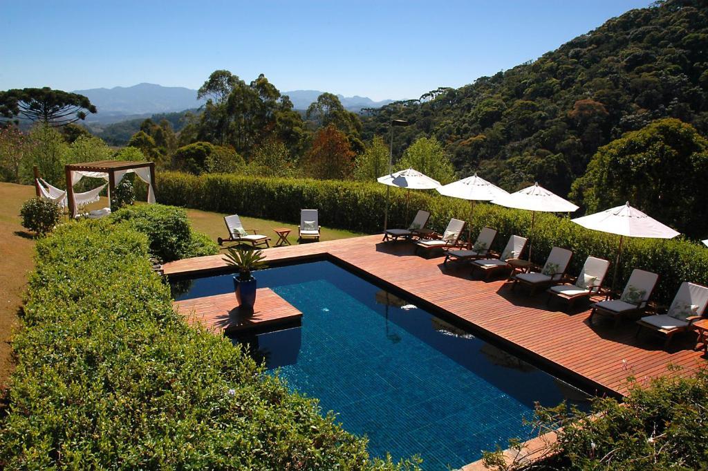 A piscina localizada em Pousada do Cedro ou nos arredores