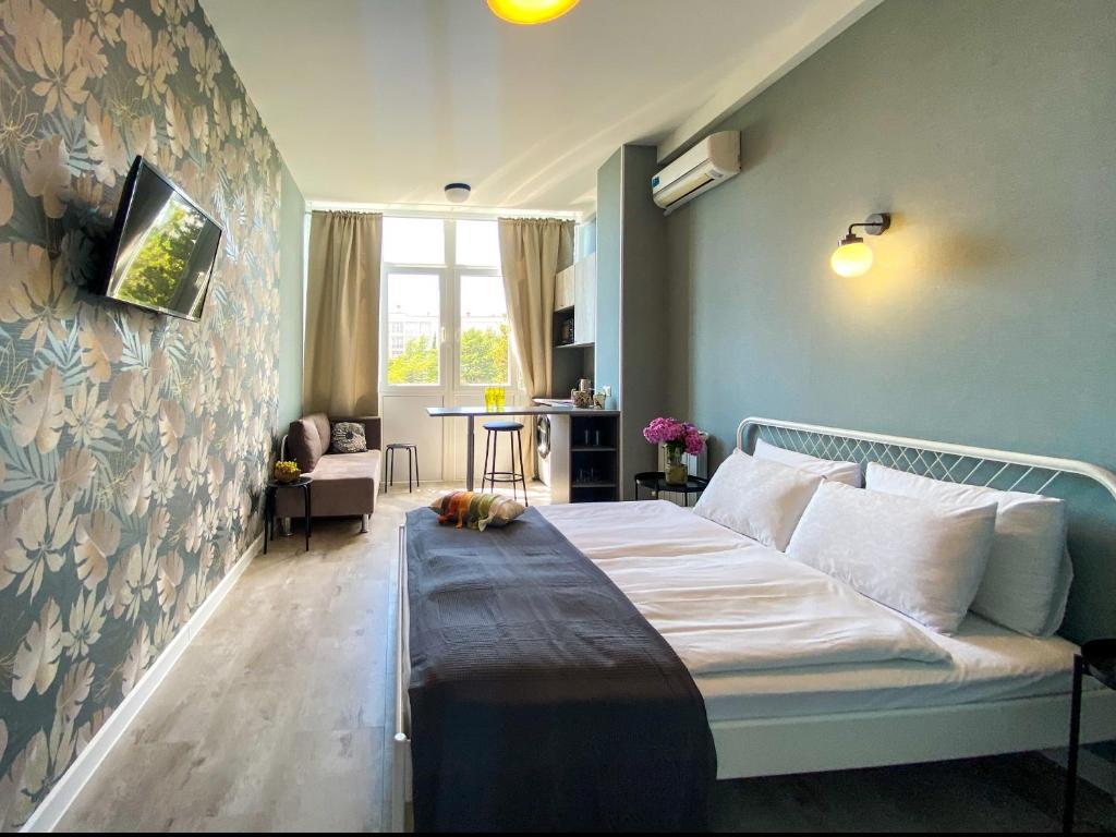 """Кровать или кровати в номере Апартаменты - квартиры """"Мира"""""""