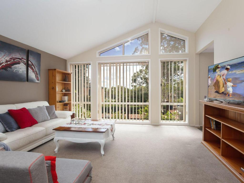 A seating area at Serenity', 7 Mulloway Place - Peaceful house with air con Netflix & WIFI