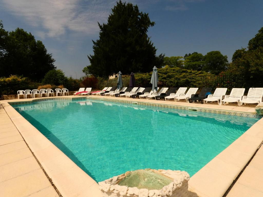 The swimming pool at or near Chateau des Mautors