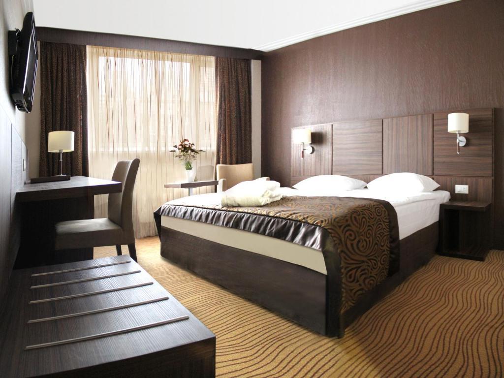 Кровать или кровати в номере President Hotel
