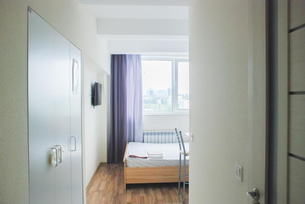 A bed or beds in a room at Smart House