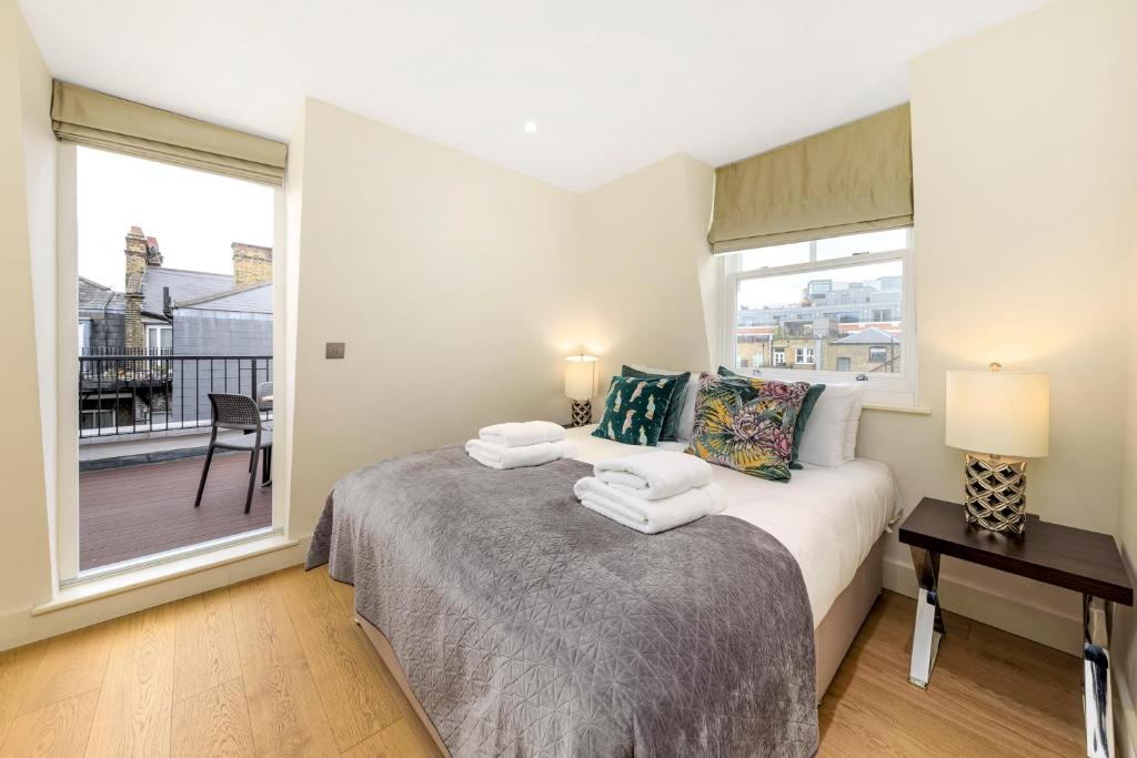 A bed or beds in a room at Fitzrovia by CAPITAL