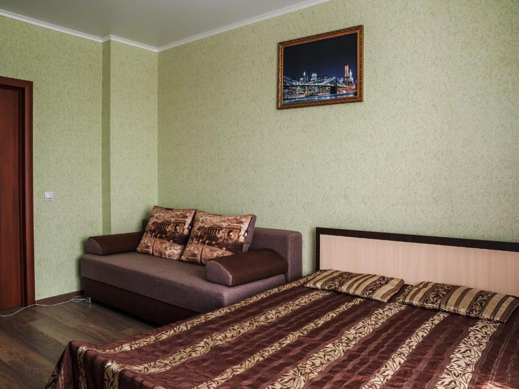 Кровать или кровати в номере Apartment on Leninskiy prospect 124b