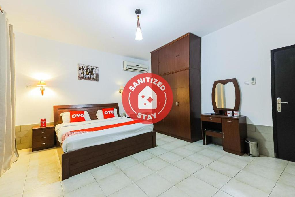 A bed or beds in a room at OYO 119 Jasmine Hotel Apartments
