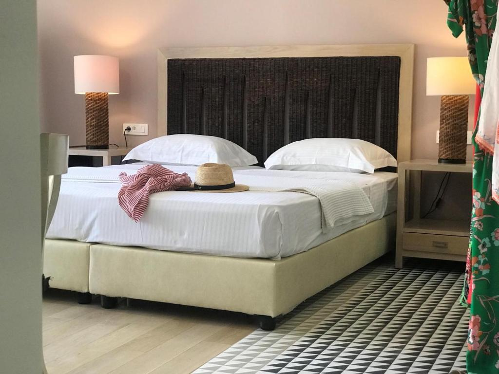 A bed or beds in a room at Vranas Ambiance Hotel