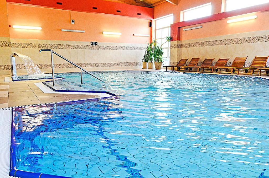 The swimming pool at or near Hotel Kudowa Manufaktura Relaksu