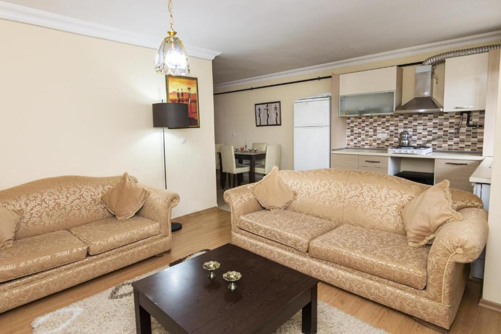 A seating area at Comfortable, near Sabiha Gokcen Airport and Viaport Shopping Center 2 BR