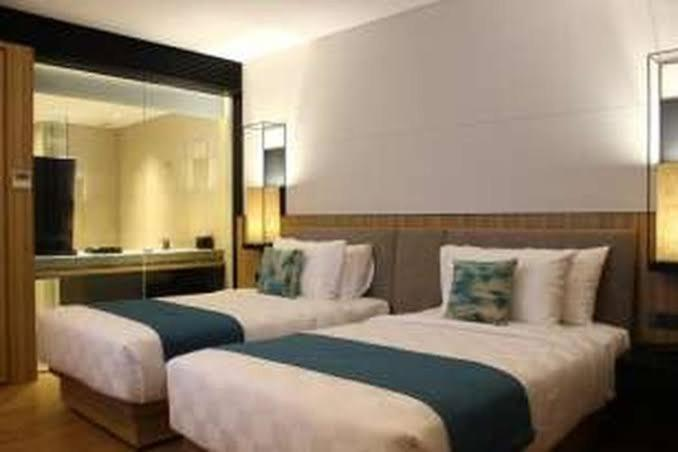 A bed or beds in a room at Agata hotel