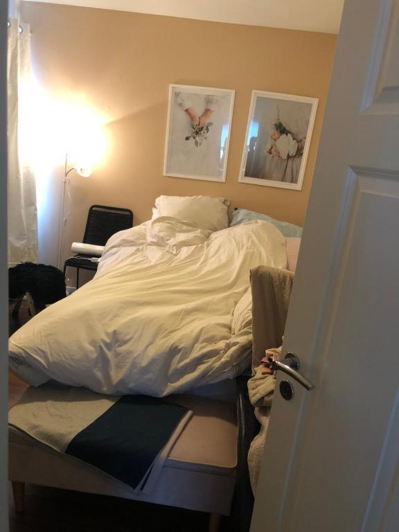 A bed or beds in a room at Vadsø sentrum 3 roms leilighet