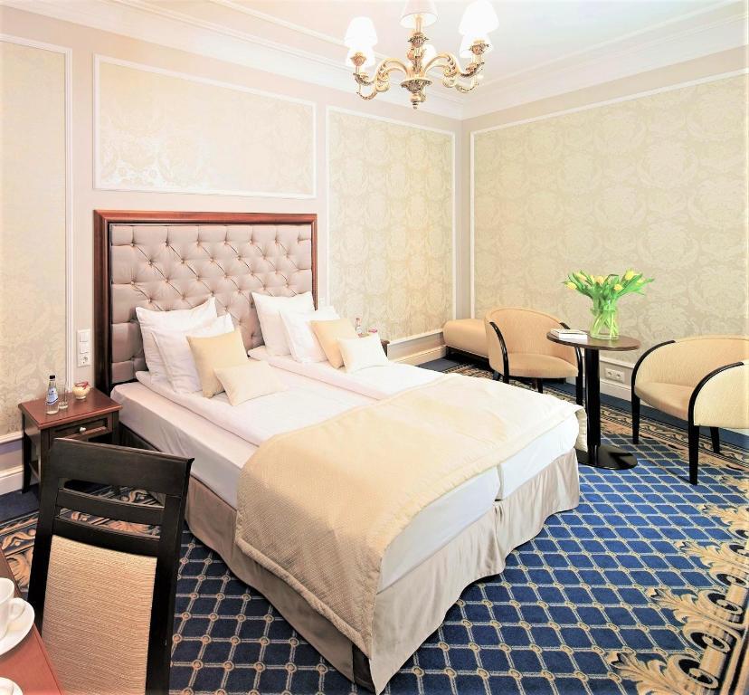 Ένα ή περισσότερα κρεβάτια σε δωμάτιο στο Rixwell Gertrude Hotel