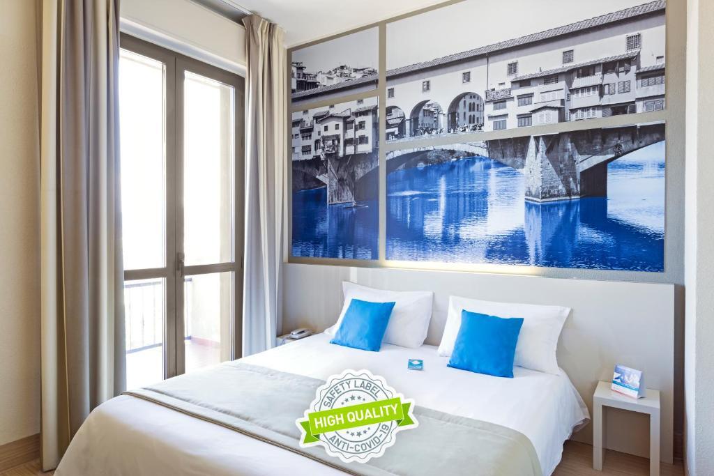 Letto o letti in una camera di B&B Hotel Firenze Novoli