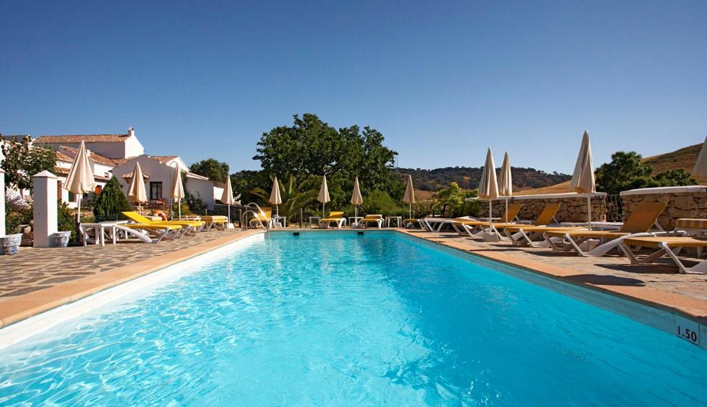 The swimming pool at or near Hotel Cortijo Las Piletas