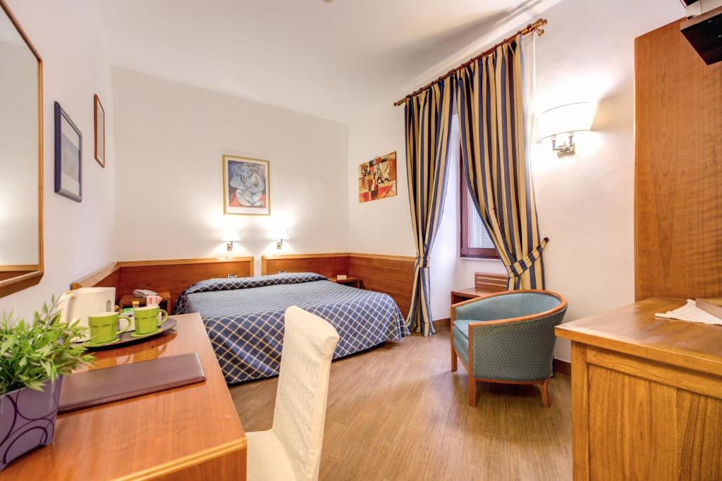 A bed or beds in a room at Hotel Gea Di Vulcano
