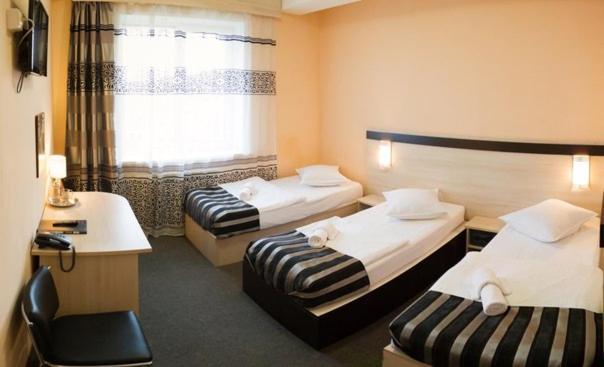 Кровать или кровати в номере Business Life