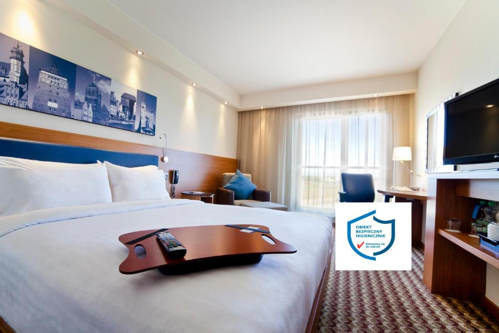 A bed or beds in a room at Hampton by Hilton Gdansk Airport
