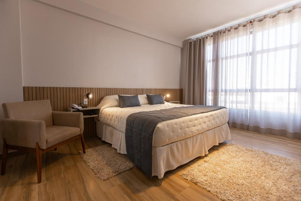 A bed or beds in a room at BM Hotel