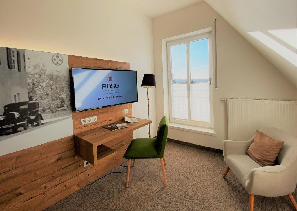 A television and/or entertainment center at ApartHotel Rose