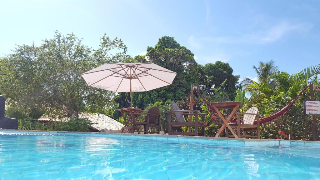 The swimming pool at or near Pousada Tubarão